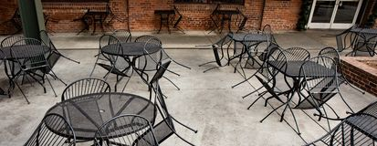 Closed outdoor seating area at an urban restaurant. stock photos