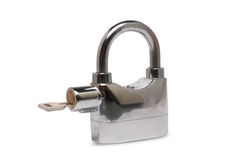 Closed Padlock and key Stock Image