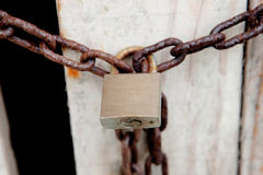 Closed padlock with rusty chain Stock Photography