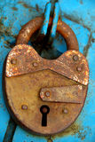 Closed padlock. Rusty old closed padlock without a key royalty free stock photo