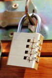 Closed padlock on a wooden door Royalty Free Stock Photos