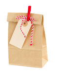 Closed paper bag with tag Stock Image