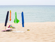 Closed parasols on the beach Royalty Free Stock Photography