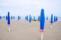 Closed parasols on the beach Sinigallia Royalty Free Stock Image