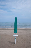 Closed parasols on the beach Sinigallia Stock Images