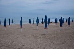 Closed parasols on the beach Sinigallia Stock Photos