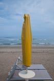 Closed parasols on the beach Sinigallia Royalty Free Stock Photos