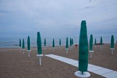 Closed parasols on the beach Sinigallia Stock Photography
