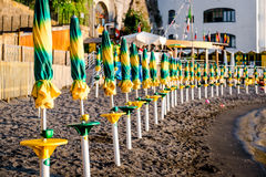 Closed parasols in a row Royalty Free Stock Photography