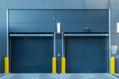Closed Parking Garage Doors. In urban apartment building stock image