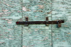 Closed peeling wooden shutter Royalty Free Stock Photo