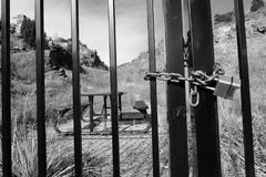 Closed picnic area in black and white. Locked and closed public picnic area in black and white Royalty Free Stock Image