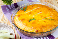 Closed pie with onions with a golden crust Stock Image