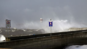 Closed pier. Hurricane in the north portuguese coast seeing a closed pear and warning signs Stock Photography