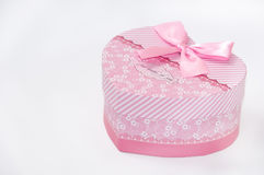 Closed pink gift box in shape of the heart Royalty Free Stock Photography