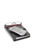 Closed Planner with Glasses and PDA. Closed Black Planner, with a silver PDA and glasses on top. On white stock photos