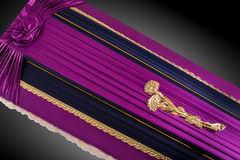 Closed Purple Coffin Covered With Elegant Cloth On Gray Background Close Up