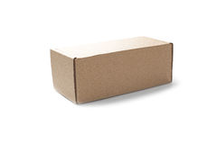Closed rectangular cardboard box on a isolated white background. Closed rectangular cardboard box on isolated white background Stock Photography