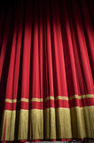 Closed red curtain. In a small theater Stock Photos