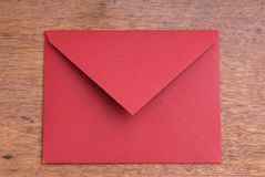 Closed Red Envelope on a Wooden Table Stock Image