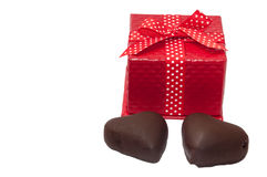 Closed red gift box with two hearts of chocolate Royalty Free Stock Photo