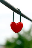 The closed red padlock in the form of heart. On the white background Stock Photo