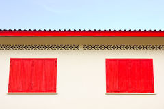 Closed red window on exterior wall Royalty Free Stock Image