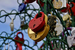 Closed red and yellow padlocks in the form of heart. Royalty Free Stock Photo