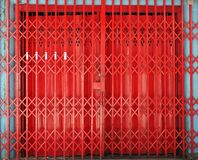 Closed retractable folding metallic gate. In front of traditional shop Royalty Free Stock Image