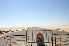 Closed road in desert Royalty Free Stock Images