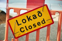 Closed road in Iceland. Closed road sifn in Iceland due to natural disaster damages. The Icelandic word translates to Closed stock photography