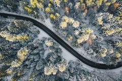 Closed road after a snowfall in the mountains. Aerial winter image of a winding road in the mountains shot with a high resolution drone royalty free stock photos