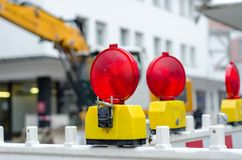 Closed road to repair. On the street background blue building construction control danger electric emergency energy equipment excavator factory fence fire gas stock images