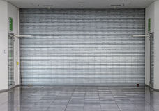 Closed roller shutter at a shop Stock Image