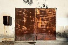 Closed rusty door Stock Photo