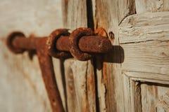 Closed rusty on an wooden door Stock Photos