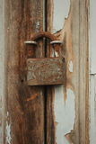 Closed rusty on an wooden door Royalty Free Stock Photography