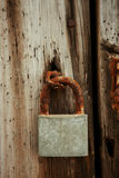 Closed rusty on an wooden door Royalty Free Stock Photo