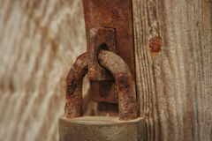 Closed rusty on an wooden door Stock Photography