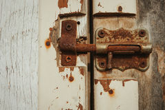 Closed rusty on an wooden door Stock Image