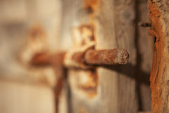 Closed rusty on an wooden door Royalty Free Stock Photos