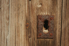 Closed rusty on an wooden door Stock Photo