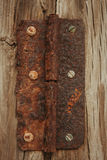 Closed rusty on an wooden door Royalty Free Stock Image
