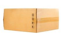 Closed shipping cardboard box isolated Royalty Free Stock Photos