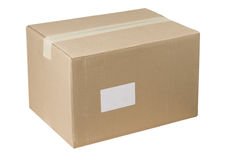 Closed shipping cardboard box whit and empty tag Royalty Free Stock Images