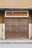 Closed shop.Corrugated door. Royalty Free Stock Photos