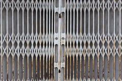 Closed shop gate. Rusted closed shop metallic gate Stock Photo