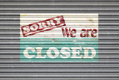 Closed Shop Sign. Metal shutter with sorry we are closed painted shop sign Stock Photos