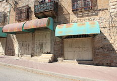 Closed Shops, Houses with Grating, Hebron. Abandoned and closed shops in the old city of Hebron. The old city of Hevron, 30 km south of Jerusalem, in the stock photo