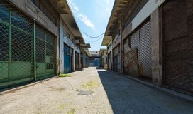 Closed shops. Poor back-street at Piraeus. Closed shops at a poor back-street near Piraeus port, Greece royalty free stock photography